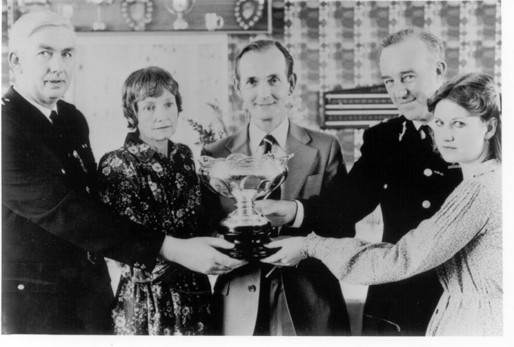 First presentation of the Caroline Symes Memorial Bowl 1978 to Chief Inspector Gerry Lewis, officer in charge Cirencester Sub-Division for the work of the Sub- Division 1978. Left to right  Chief Inspector G. Lewis, Mr and Mrs Symes, Chief Constable  Brian Weigh Queens Police Medal , and Caroline's sister. (Gloucestershire Police Archives URN 248)