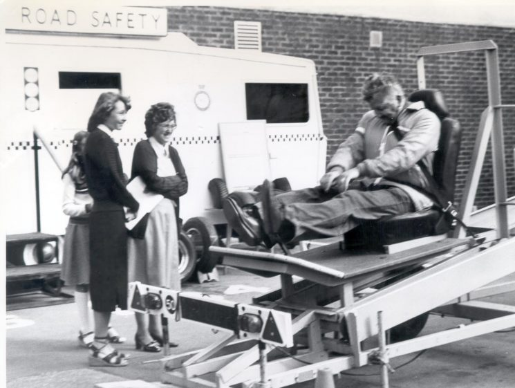 Open Day at Police Headquarters 1979 showing members of public on road safety equipment. (Gloucestershire Police Archives URN 270)