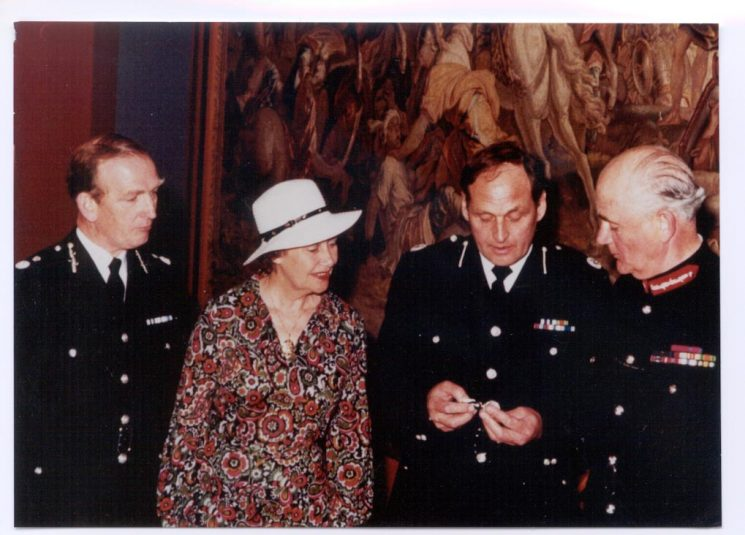 Award of Queens Police Medal  to Deputy Chief Constable E. Whitmore photograph includes Chief Constable Soper; Mrs Whitmore and Lord Lieutenant Colonel Gibbs. (Gloucestershire Police Archives URN 284)