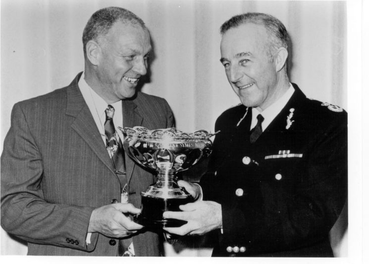 Chief Constable Brian Weigh Queens Police Medal presenting Caroline Symes memorial Bowl to Police Sergeant Don Chidzoy 1979. (Gloucestershire Police Archives URN 319)