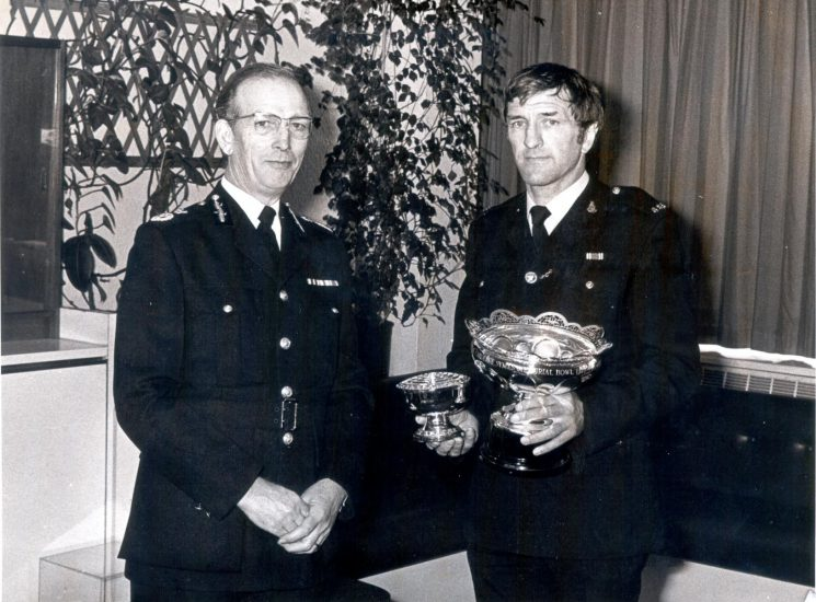 Chief Constable Soper with winner of Caroline Symes Memorial bowl, Police Constable Winston Morris from Coleford  1983. (Gloucestershire Police Archives URN 367)
