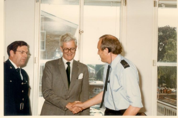 Right Honourable Douglas Hurd visit to Police Headquarters Control Room and meeting Chief Inspector J. Coopey and Police Constable S. Willis. (Gloucestershire Police Archives URN 383)