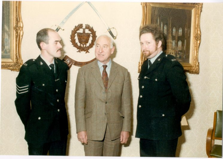 Police Sergeant A. Grimmett and Police Constable K. Lavendar, winner and runner-up of Colburn Trophy 1984 with Mr. Oscar Colburn Commander British Empire; Justice of the Peace; Deputy Lieutenant. (Gloucestershire Police Archives URN 389)