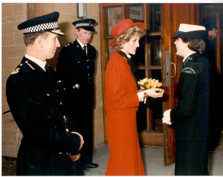 Princess of Wales at Cirencester Police Station meeting Cadet R. Price.   Chief Constable Soper and Inspector E. Whitlock also in picture. (Gloucestershire Police Archives URN 400)