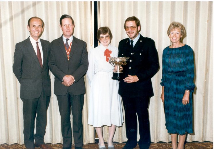 Presentation by County High Sheriff, Major M.P. Wills, of Caroline Symes award to Police Constable C. Brewster 1985. Left to right: Mr.Symes; High Sheriff Wills; Mrs Brewster; Police Constable Brewster and Mrs Symes. (Gloucestershire Police Archives URN 428)