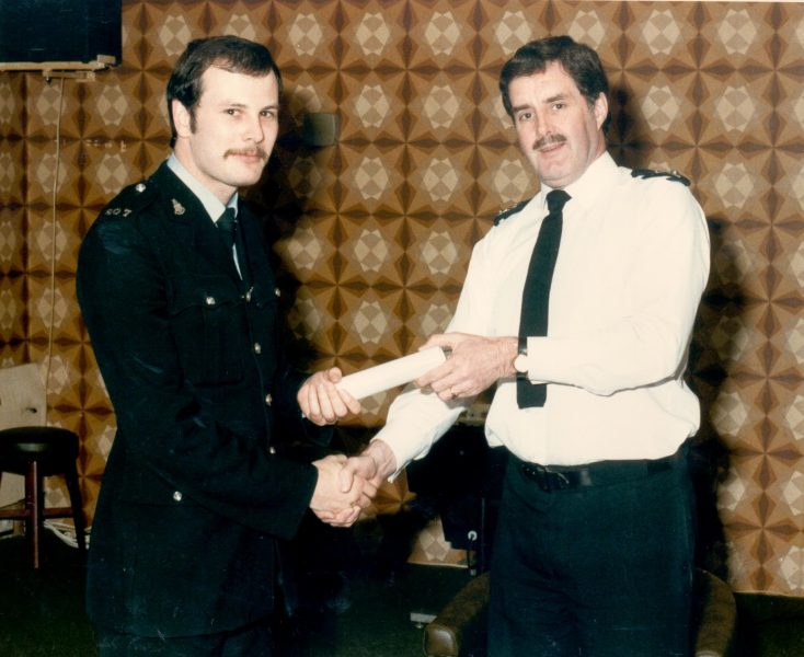 Chief Superintendent Joe Skipsey presenting Police Constable Paul Menhinick with his award for bravery. 1986. (Gloucestershire Police Archives URN 475)