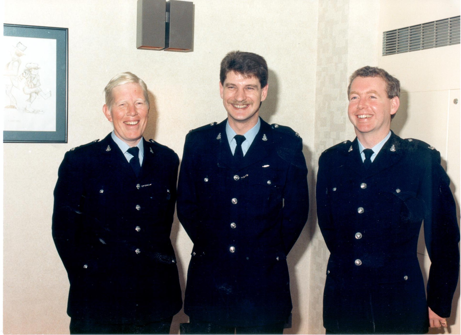 Presentation of bravery awards. Police Constable Bill Matthews after receiving his bravery award for the Gloucester siege with two colleagues involved in the incident 1987. Left to right Police Constables Anthony Webb, Bill Matthews, Patrick Price. (Gloucestershire Police Archives URN 485)