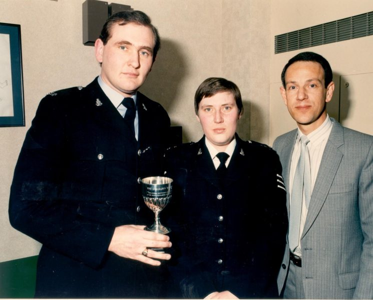Inspector Edward Baud with two members of his shift who took first and second prizes  in the 1987 Colburn Trophy. First prize winner Police Constable Patrick Geenty (Chief Constable of Wiltshire May 2012 to May 2015) and second prize winner Woman Police Sergeant Ann Green. (Gloucestershire Police Archives URN 510)