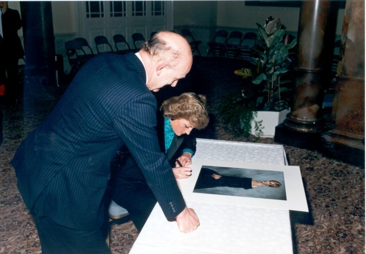 Princess of Wales signing  a photograph  150th anniversary Cheltenham 8th April 1989 with Chief Constable Pacey. (Gloucestershire Police Archives URN 516)