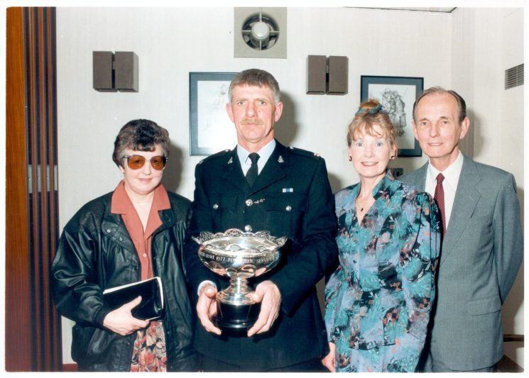 Caroline Symes Memorial bowl 21 March 1990 Winner Police Constable Brian Milner  with his wife and Mr and Mrs Symes. (Gloucestershire Police Archives URN 523)