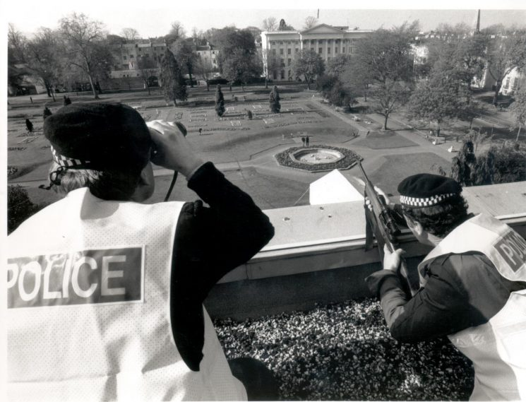 Armed police on roof tops Imperial Square  during the visit of Prime Minister Margaret Thatcher to Cheltenham for Conservative Party conference 30/31 March 1990. (Gloucestershire Police Archives URN 528-8)