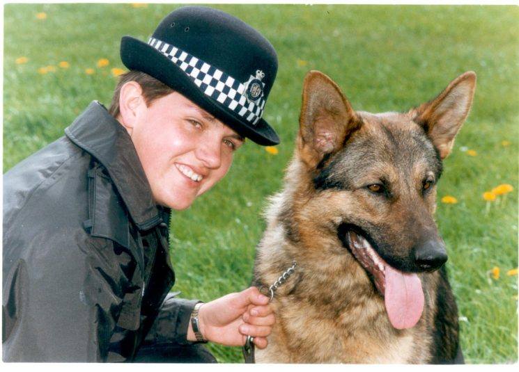 Woman Police Constable Cindy Purnell first female dog handler in Gloucestershire Constabulary 1/10/1990 with German Shepherd Charlie. Training officer Police Constable David Carter said