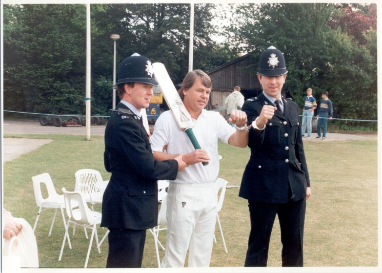 150th Anniversary Cricket Match Chief Constable's. Team XI versus Gloucestershire County Cricket Club 1989 showing Cricketer Mike Proctor posing for media photos with Police Constables Frank Harris and John Taylor. (Gloucestershire Police Archives URN 534)