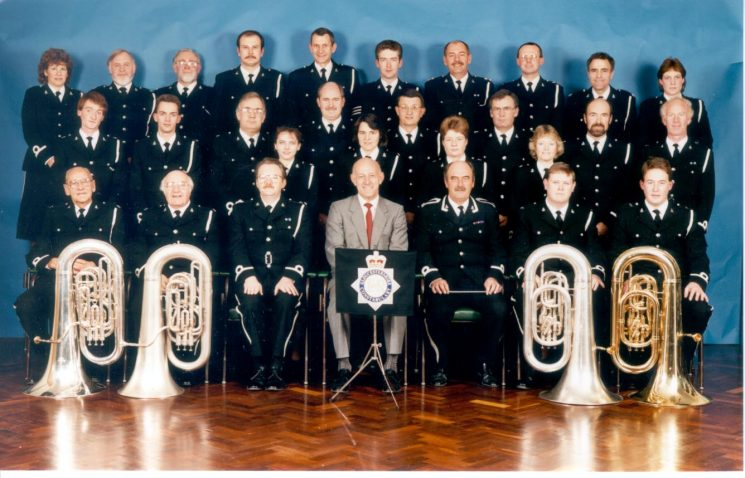 Gloucestershire Constabulary Band in their new uniforms  with Chief Constable Albert Pacey, Queens Police Medal,1990. (Gloucestershire Police Archives URN 538)