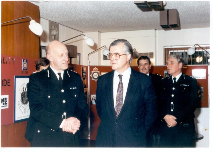 Home Secretary Kenneth Baker visiting Gloucestershire Constabulary on his first day in office. 28.11.1990. Photo includes Chief Constable Albert Pacey Chief Superintendent Joe Skipsey and Deputy Chief Constable Lou Whitton. (Gloucestershire Police Archives URN 544)