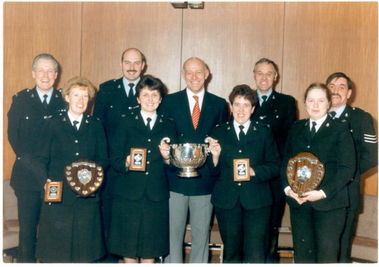 Regional First Aid competition Number Six Region for the Pim Trophy at Police Headquarters Cheltenham 12/01/1991. Back row left to right:  Police Constables John Willliams, Peter Bowen,  John Squires,  Dick Green Front row:  Woman Detective Constable Carol Mein, Woman Police Constable Chris Skorski, Centre Chief Constable Albert Pacey, Woman Police Constable Mary Wild,Woman Police Constable  Barbara Banning. (Gloucestershire Police Archives URN 554)