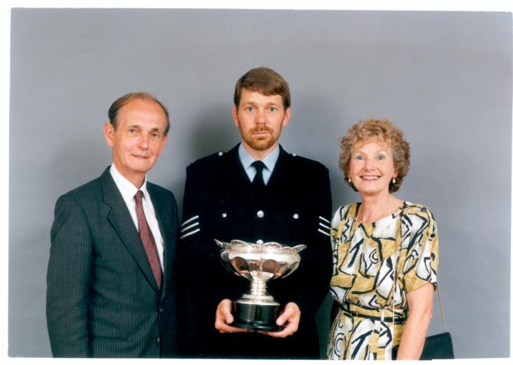 Presentation of Caroline Symes Memorial Bowl to Police Constable Chris Williams for his work in the Scout Movement 1991.With Mr and Mrs Symes. (Gloucestershire Police Archives URN 556)