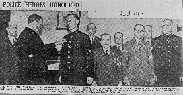 Forest of Dean Gazette, March 1940 showing Chief Constable Henn presenting silver braid for Conspicuous Gallantry to Police Constable V. J. Bullock , Special Constable W. F. Williams, Special Constable W. E. Prisk and Police Sergeant F. F. Taylor. (Gloucestershire Police Archives URN 569)