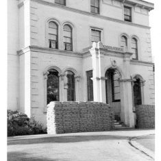 The  front of Holland House sandbagged during war time. It was later damaged by a bomb and  on 31st December 1940 the Chief Constable reported that to temporarily accommodate staff he had rented rooms in a house opposite Head Quarters at £2 per week. On 1st February 1942 the Force had to relinquish this property and four rooms were rented in Wilton House. These rooms were given up on 27th March 1943 as the repairs had been completed which enabled staff to move back in to Holland House. (Gloucestershire Police Archives URN 593)