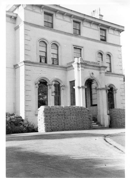 Front of Holland House sandbagged during war time. (Gloucestershire Police Archives URN 593)