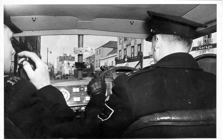 Traffic officers in a Riley Patrol car Police Sergeant Squires and Police Constable Wise 1950s. (Gloucestershire Police Archives URN 629)