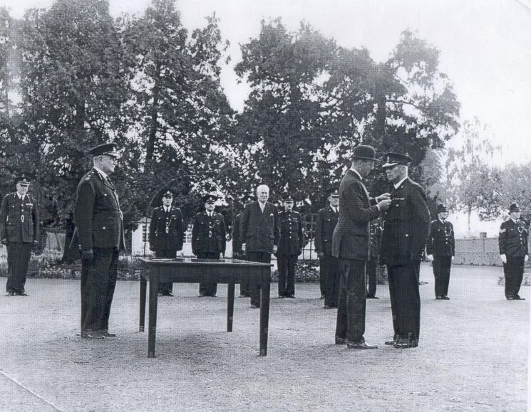 Presentation of Queens Police Medal to Superintendent C.F. Large by the Duke of Beaufort. (Gloucestershire Police Archives URN 663)