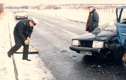 Police Constable Paul Crabtree at scene of road accident. (Gloucestershire Police Archives URN 693)