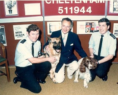 Police Constable Graham Hale, Paul Eddington and Police Sergeant Peter Voisey Dog Section with dogs at launch of the Drugs hotline. (Gloucestershire Police Archives URN 700)