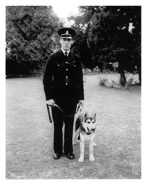 Police Constable Ben Smith  with his dog Chan 1960s. (Gloucestershire Police Archives URN 713a)