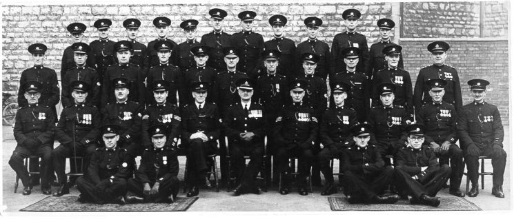 Cheltenham Special Constables around 1946. Showing (centre seated) Superintendent A. Hopkins and (front standing row extreme right) Inspector J Hallam. (Gloucestershire Police Archives URN 718)
