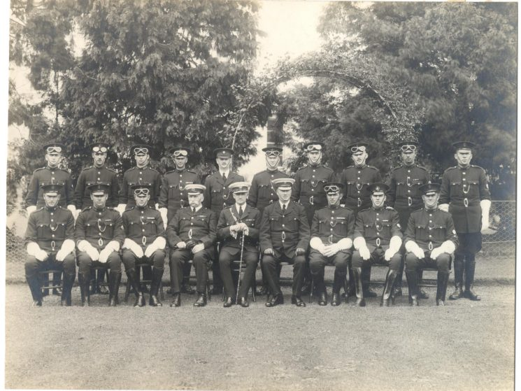 Motor Patrol 1931 when staff increased from four to fifteen. Back Row: Police Constables  Dale, C.A .Smith,  Robinson, Luton, Inspector A.W. Hopkins, Police Constables   Allsop,  Blundell,  Baker,  James,  Finch. Front Row: Police Constables  Pole,  Jack Greenall,  Morton Fluck, Deputy Chief Constable A.W. Hopkins, Chief Constable F.L .Stanley-Clarke, unknown Superintendent, Police Constables  Tremlin,  Levell,  Mills (Gloucestershire Police Archives URN 72)