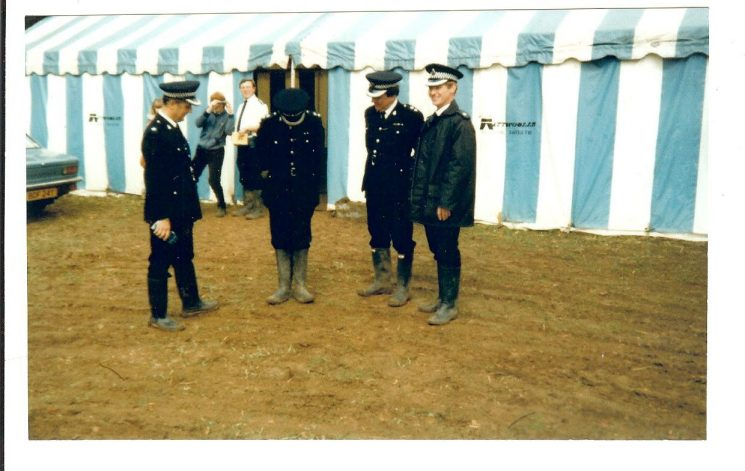 Gatcombe Park Horse Trials 1984. Left to right Superintendent Roger Pearce, Chief Superintendent  Alan Bobs, Chief Superintendent Graham Murdock,  Superintendent Colin Stabler, in background Chief Inspector Roy Fisher. (Gloucestershire Police Archives URN 749)