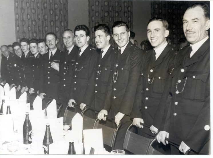 Sheriffs Dinner, Gloucester 1957. Right to left: Police Sergeant  R. Cook, Police Constables B. Marshall,  Peter Deacon, Trevor Williams,  Douglas Kimber,  L. Ryland,  Les Scuse, Cadets Dangerfield, Jefferies, Moody others unknown. (Gloucestershire Police Archives URN 778)