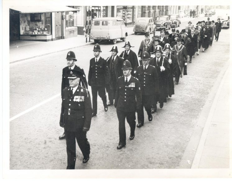 Civic procession to Gloucester Cathedral with Police officers heading parade 1958. Superintendent Hart Police Constables W. Stokes; John D. Jones; Peter Harris; Ewart Bradley. (Gloucestershire Police Archives URN 783)