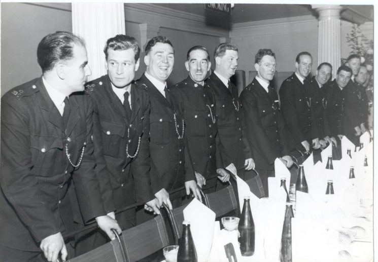Sheriffs Dinner, Gloucester 1957. Left to right: Police Constables  Brian Stoneham,  Peter Excell, Ron Peacey, unknown Special Constable, Police Constables   Ron Evans,  John Gardiner,  P Garner, Len Phillips,  T. Jones two unknown. (Gloucestershire Police Archives URN 784)