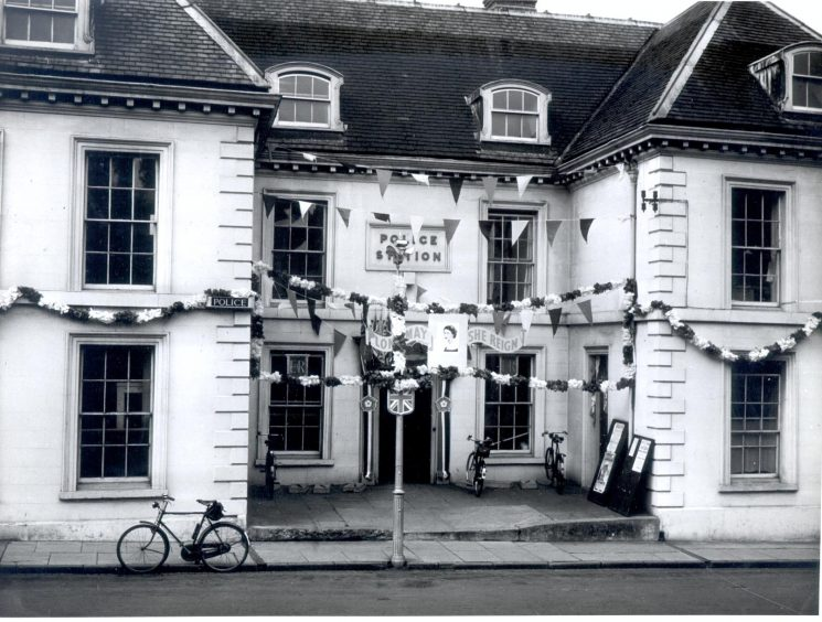 Gloucester Bearland Police Station, Longsmith Street, decorated on the occasion of the Queen's coronation. (Gloucestershire Police Archives URN 790)