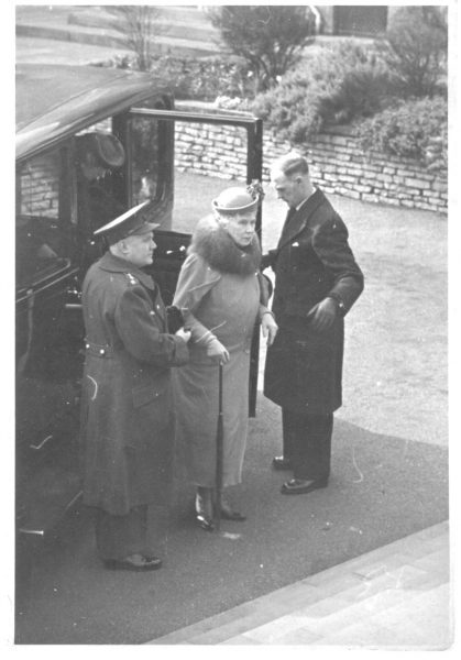 Inspector George Gardner assisting Her Majesty Queen Mary on royal visit. Inspector Gardner was seconded to Badminton House during the second world war as  Queen Mary's personal police officer. (Gloucestershire Police Archives URN 800)