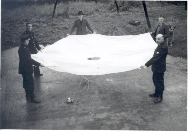 Police officers inspecting war-time parachute at Filton 1944. (Gloucestershire Police Archives URN 808)