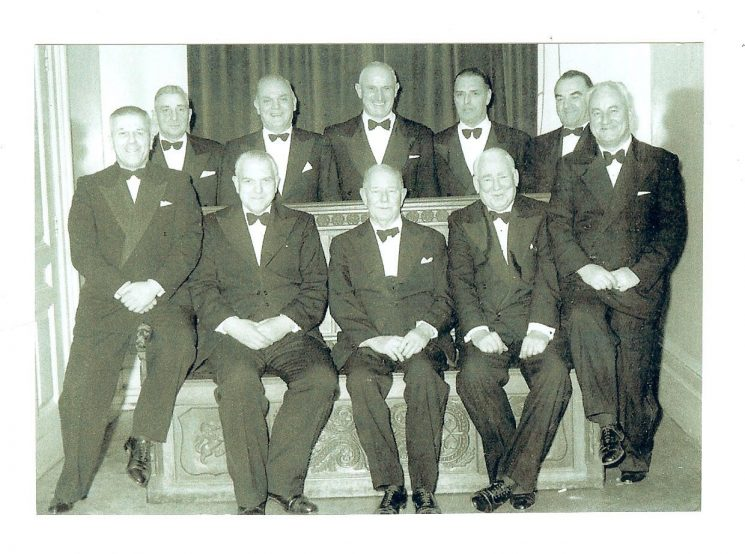 Officers in evening dress 1958. Back row left to right: Superintendents W. Hart, H. J. Price, S. D. Smith, H. D. J. Smith, F. Statham, Cyril Milner, P. Oakley, Seated centre: Assistant Chief Constable A. H. Carter, Chief Constable Colonel Henn, Superintendent Bert Hancock. (Gloucestershire Police Archives URN 809)