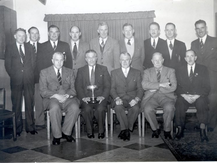 Skittles team 1958. Back row right to left : Harry Thomas, Horace Tredwell, Les Skuse, Ivor Jones, Fred Elliot, Tony Jefferies, Louis Wyatt, Cyril Clark, John Gray. Front row right to left : Charles Walkely, Chief Constable Colonel Henn, unknown, William Hart, Assistant Chief Constable H. Carter. (Gloucestershire Police Archives URN 824)