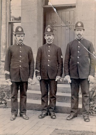 Three officers outside Lydney Police station in the late 19th century. Sergeant on left of group is William Morris, who was stoned to death at Viney Hill on 10th November 1895 aged 32. (Gloucestershire Police Archives URN 858)