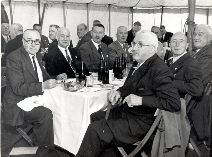 Police Pensioners Dinner held in marquee at Gloucester circa 1955. On extreme right is Police Constable Richard Tibbotts.  On the extreme left is Steve Wickham. Others unknown. (Gloucestershire Police Archives URN 872)