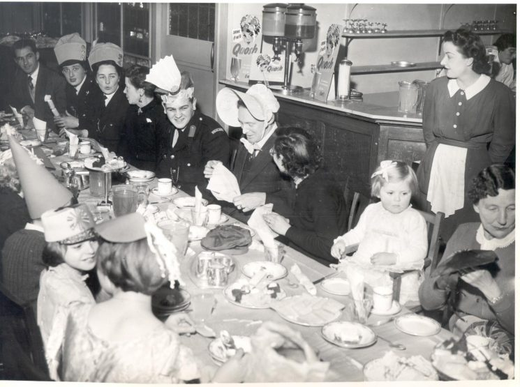 Childrens Christmas Party held at Cadena Café Gloucester 1954. Right to left: Mrs Hart, Susan Hart, Jean Gray,  Chief Inspector John Gray, Cadet Peter Day, Woman Police Constable Olive Hinton. (Gloucestershire Police Archives URN 888)