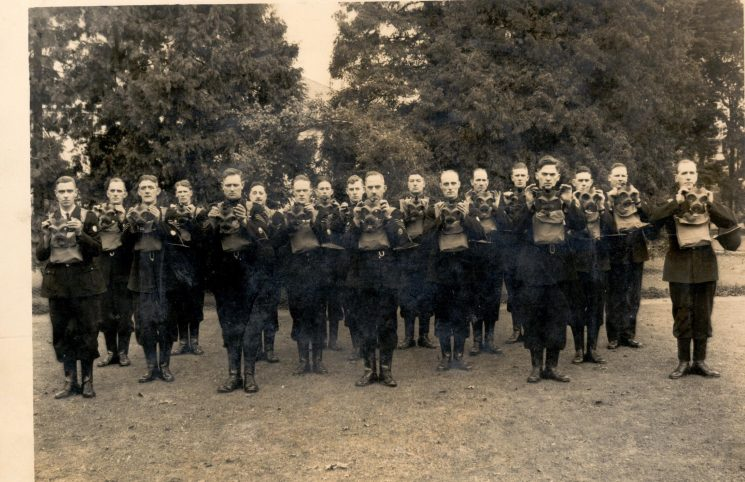 Officers undergoing gas-mask training 1940. Taken at rear of Police headquarters. Officers identified, seventh from left Police Sergeant George Gardner, eighth from right Police Constable Tom Pittaway. (Gloucestershire Police Archives URN 921)