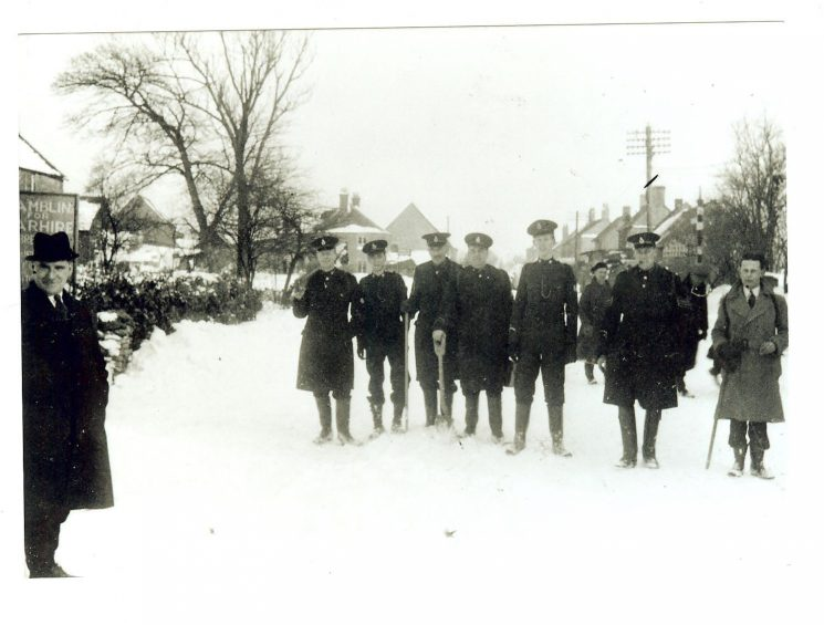 Staff at Birdlip having carried food supplies to cut-off village. Winter 1947. (Gloucestershire Police Archives URN 946)