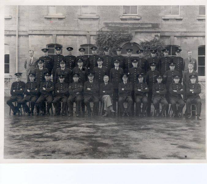 Driving Course at Devizes (Regional driver training centre).  Number one course October 1945 Gloucestershire Officers shown - Police Constable Norman Stevens second uniform officer middle row second from right:  Police Constable Bernard Sanders second uniform officer from left, back row:  Back row seventh  uniform officer from left PC Ken Beszant. (Gloucestershire Police Archives URN 971)