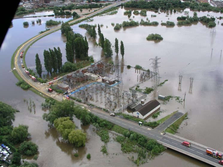 Castle Mead, Gloucester surrounded by flood water in July 2007 during the Major Incident. Photo shows bund (in blue) being constructed around it. (Gloucestershire Police Archives URN 2012)