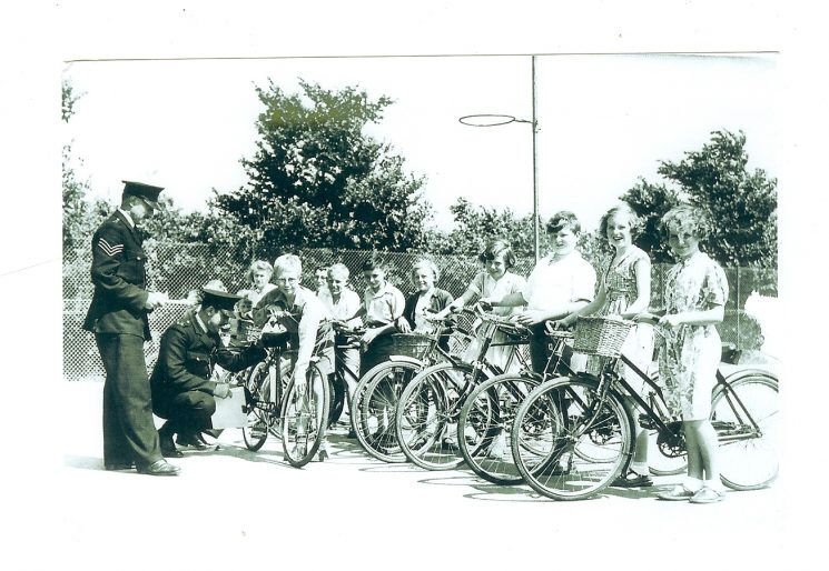 Police Sergeant Tom Pugsley and Police Constable Tony Jefferies with Cycling Proficiency Class. (Gloucestershire Police Archives URN 1048)
