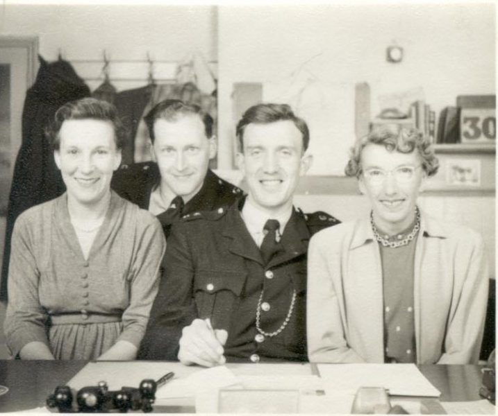 Cheltenham  Division Office Staff Police Constables  Francis and  McMahon with two civilian staff 1957. (Gloucestershire Police Archive URN 1068 )