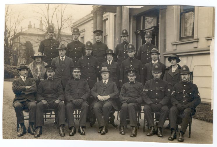Headquarters staff in 1920 outside New Court Police Headquarters, Lansdown Rd. Cheltenham. Back Row left to right; Police Constables Crouch, Jotcham, Orderly Keyse, Police Constables Lippett, Wynniatt. Middle row left to right: Miss Watts, Police Constables Williams, Large, Woman Police Constable Hagley, Police Constables Wakefield, Birchard, Miss Stowell. Seated left to right: Police Sergeant T.A. James, Inspector J Evans, Superintendent J.B. Biggs, Chief Superintendent Cooke, Inspector A. Sainsbury,Police Sergeants J.A. Price, G. Pugh. (Gloucestershire Police Archive URN 116) | Cheltenham Chronicle and Gloucester Graphic
